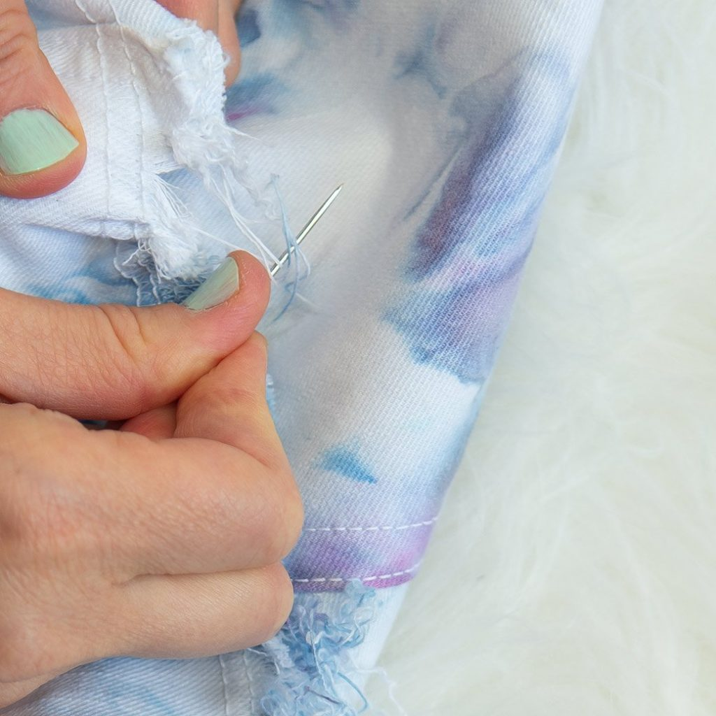 making a raw denim hem on an upcycled denim skirt