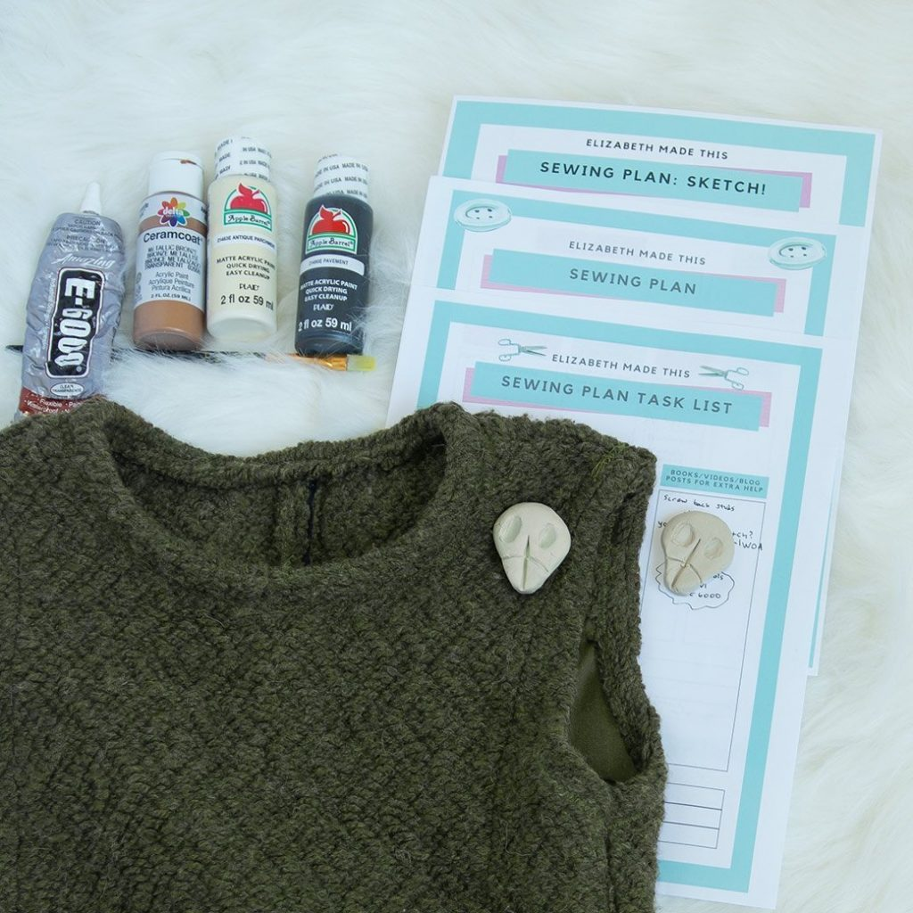 sewing with a plan: costume in progress with planner pages, paint and glue, and items to glue