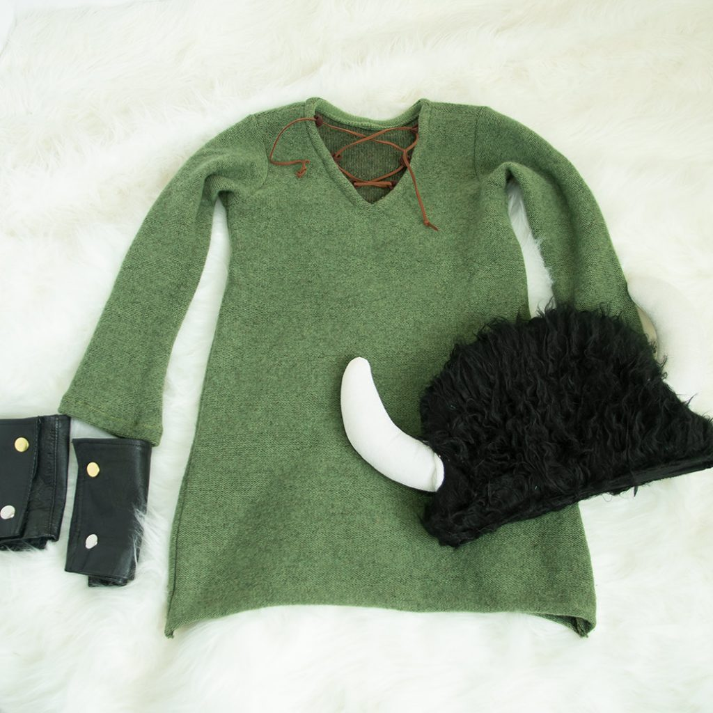 pattern hacked sweater, viking hat, and leather cuffs