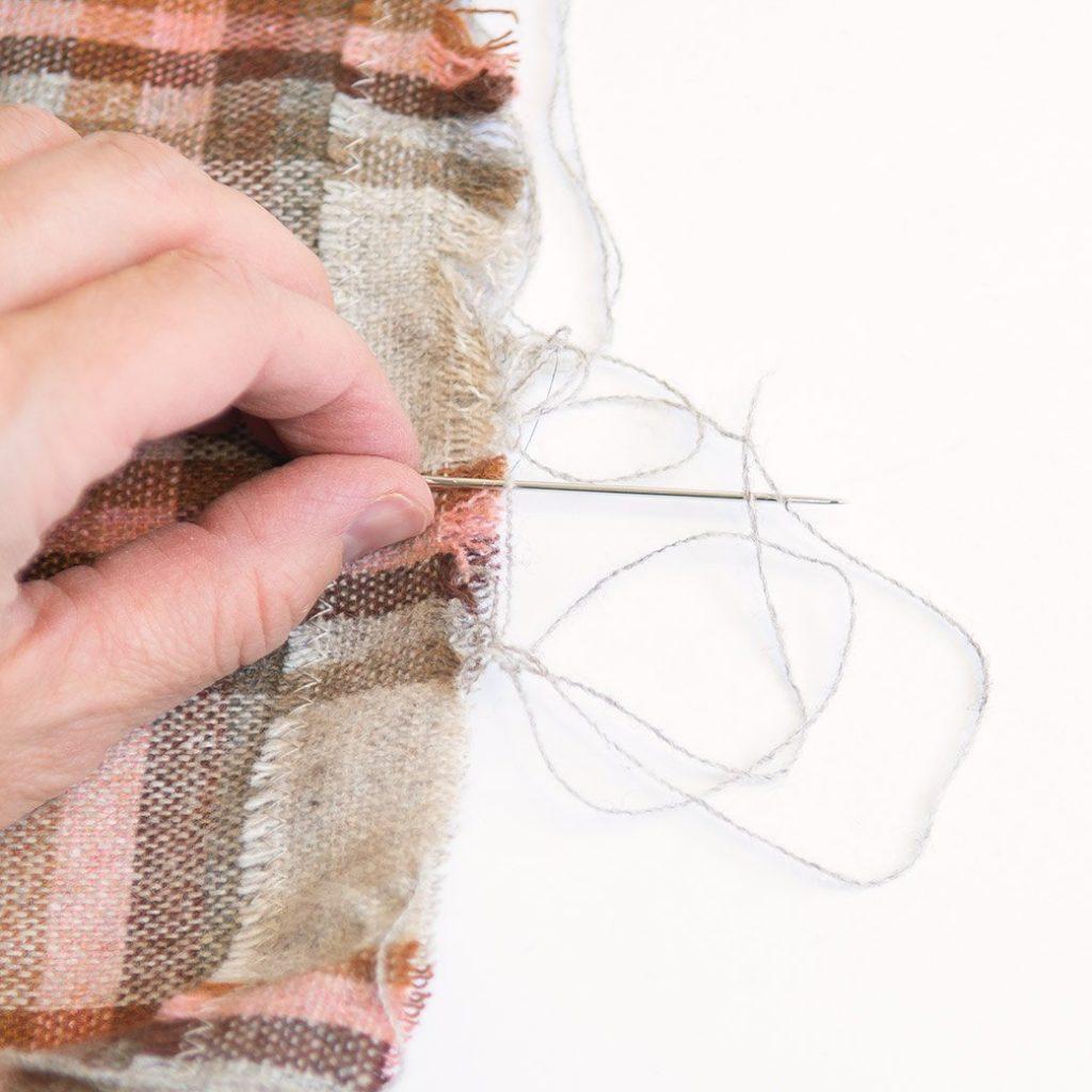 How to make a fringe scarf: using a needle to make fringe