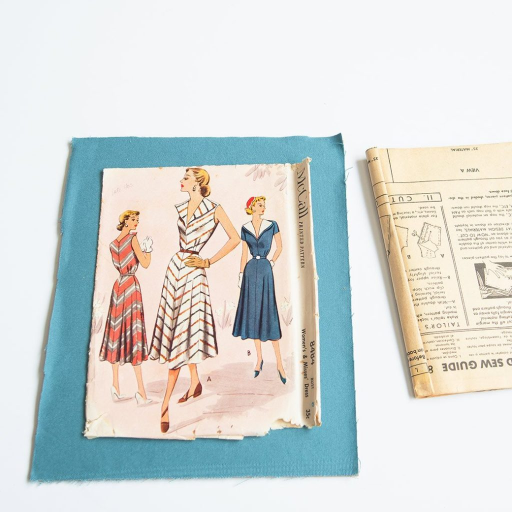 vintage pattern mounted on fabric for sewing room decor