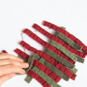 weaving strips to make a woven mug rug
