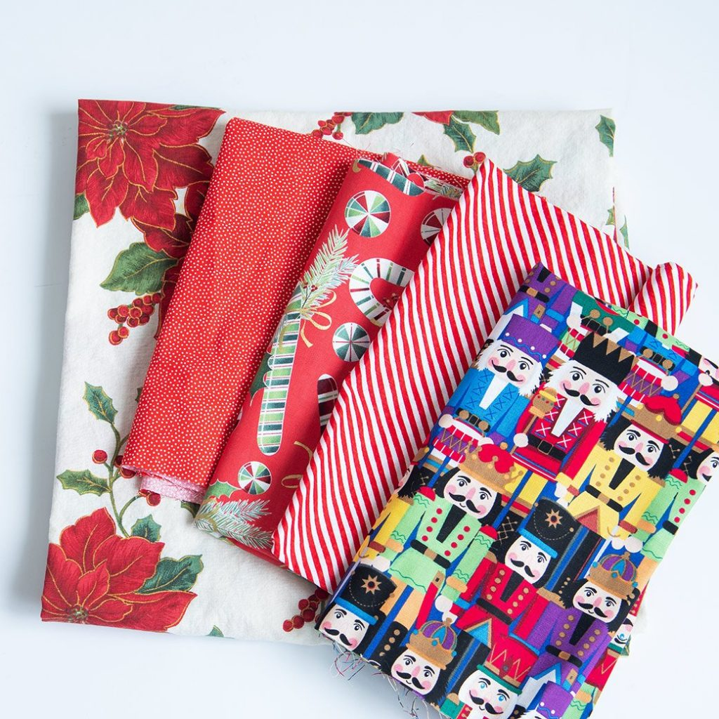 collection of Christmas fabrics for a sewing snow day