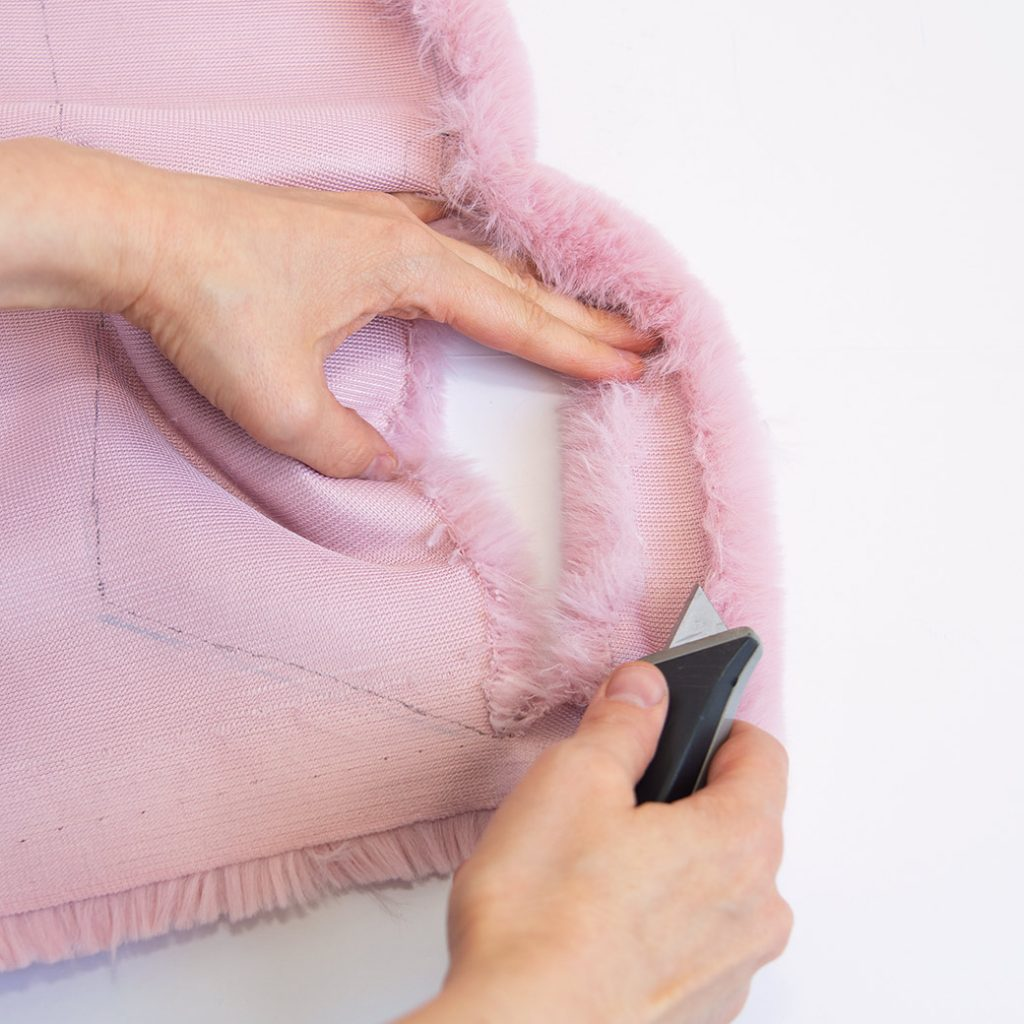 how to sew faux fur: cutting faux fur with a box cutter