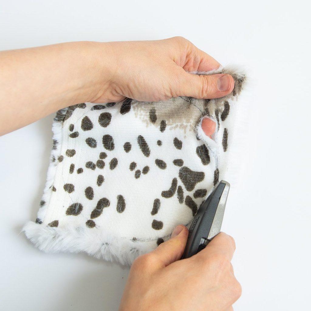 cutting faux fur with a box cutter