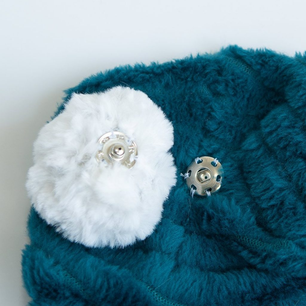 winter hat with #10 snap and faux fur pom pom
