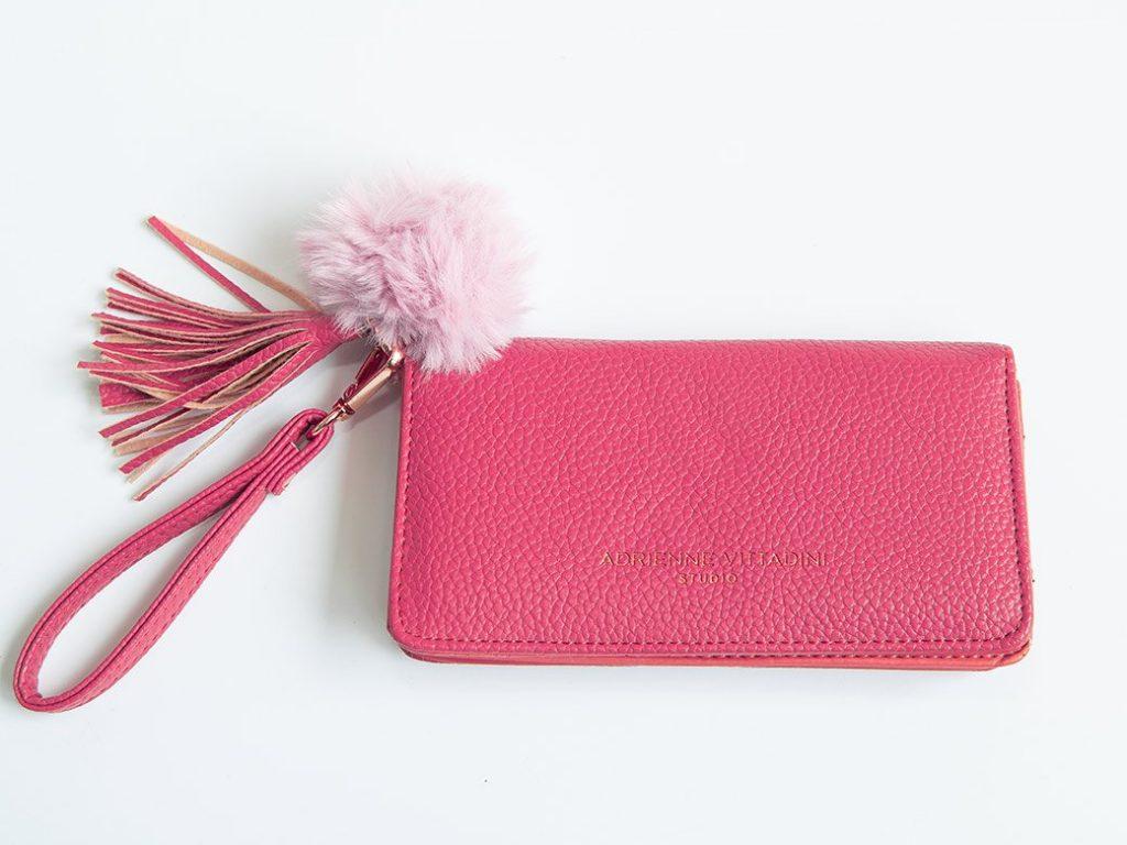 faux fur pom pom added to a purse