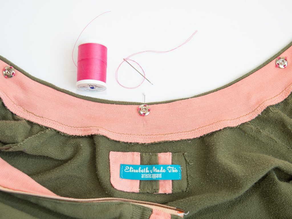 sewing snaps to neck on a jacket for a detachable faux fur collar