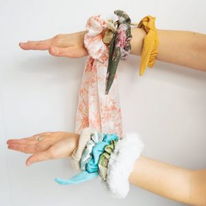 hands wearing scrunchies
