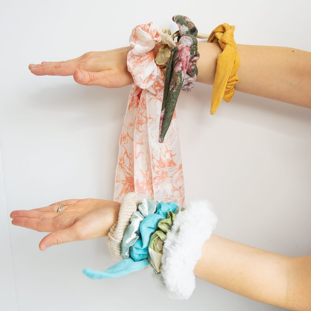 hands wearing scrunchies
