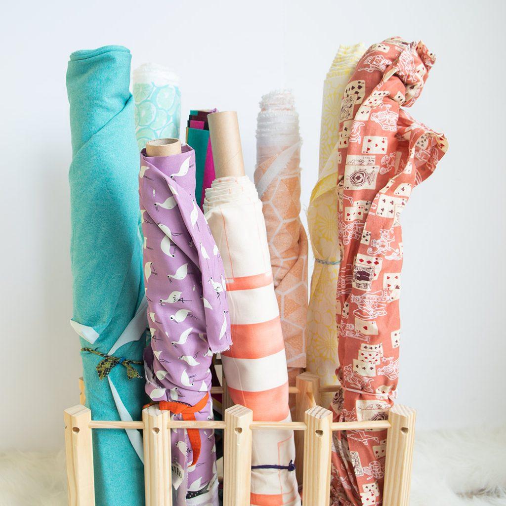fabric on rolls in wine rack