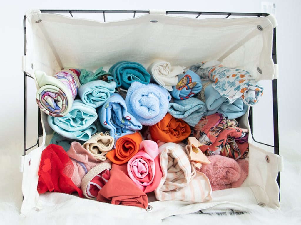 knit fabric scraps rolled in basket