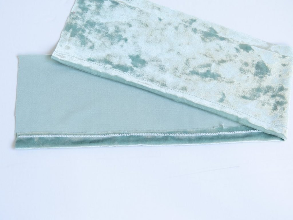 hemmed bottom edge on stretch velvet