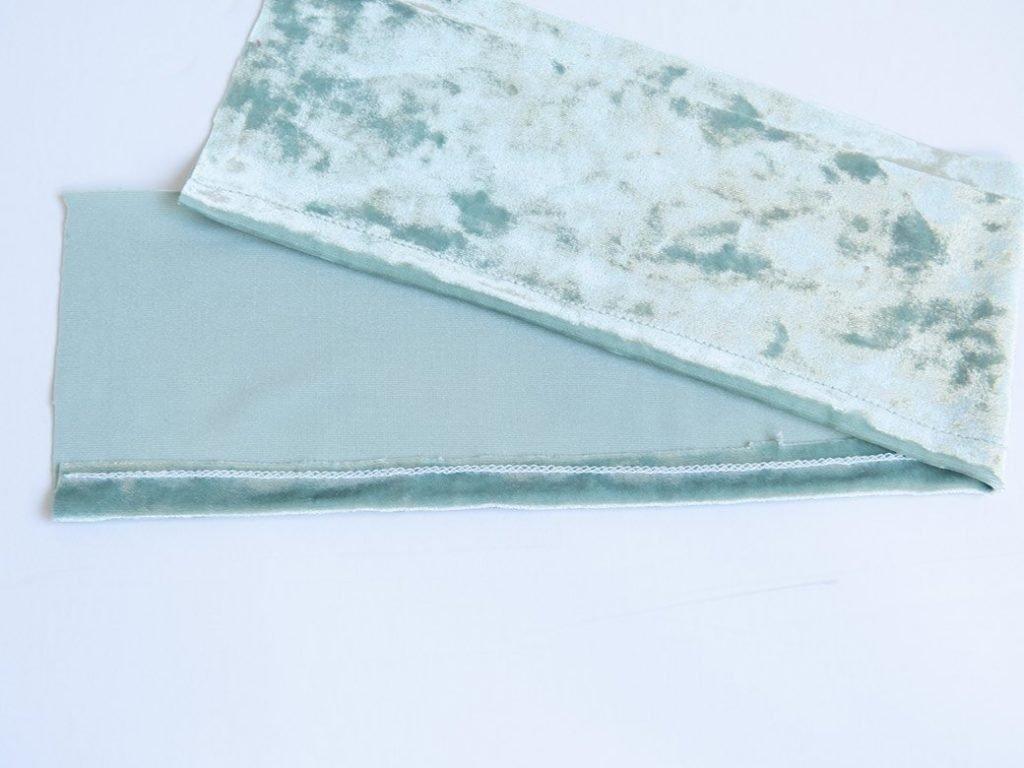 hemmed bottom edge on stretch velvet