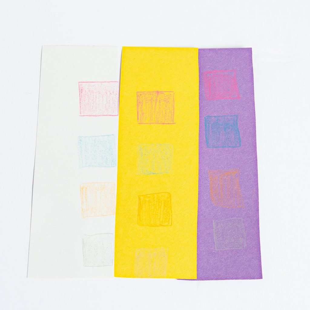 colored pencil swatch squares on construction papers