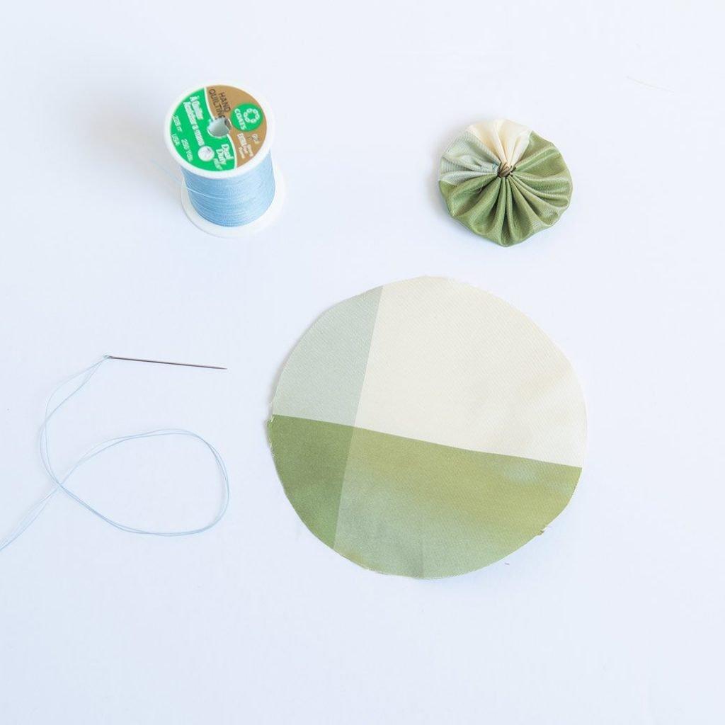 fabric yoyo cut plus thread, needle and finished yoyo