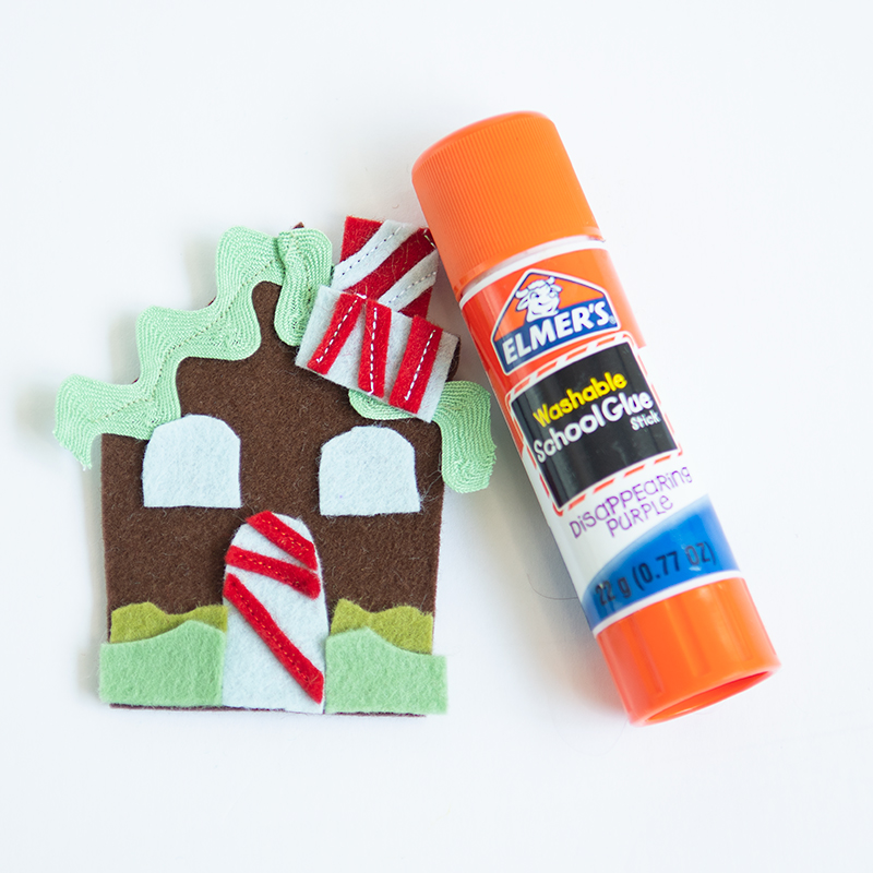 gluing mini gingerbread house