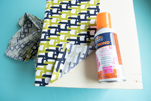 gluing on fabric to lampshade for diy lampshade makeovers